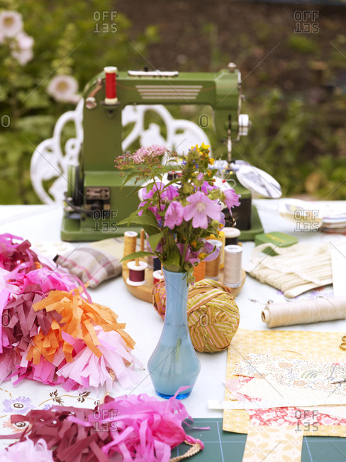 Sewing equipment on table outside