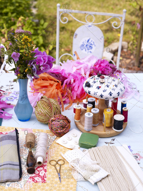 Sewing equipment on table outdoors