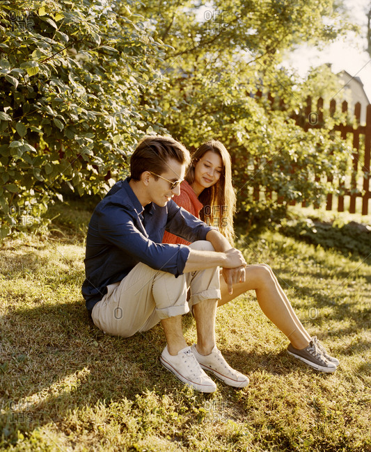 A young couple sitting in a park