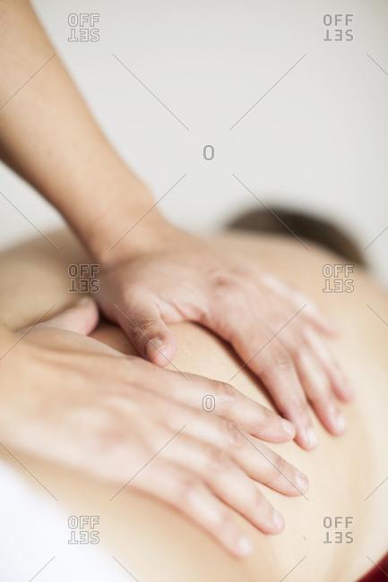 Hands giving a back massage
