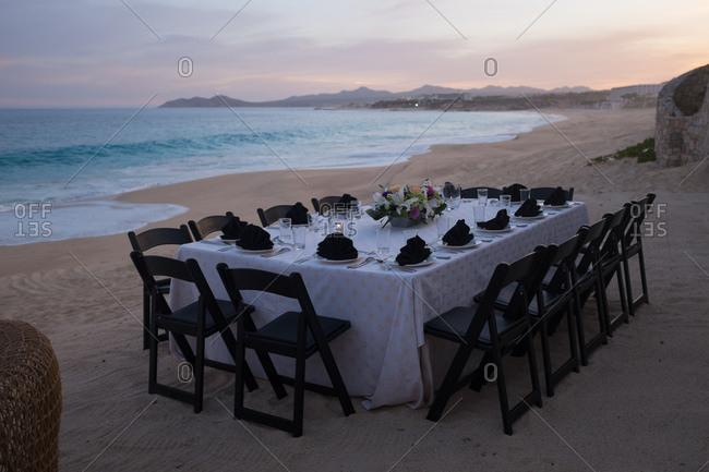 Table set for dinner on a beach