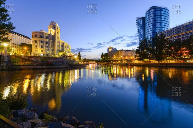 Urania, Austria - May 18, 2015: Uniqa Tower and Danube channel in the evening, Urania, Austria