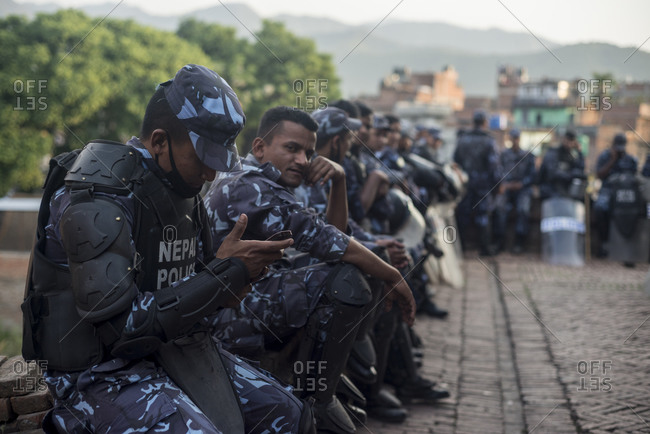 Bhaktapur, Nepal - April 14, 2014: The Nepalese police force sitting on wall