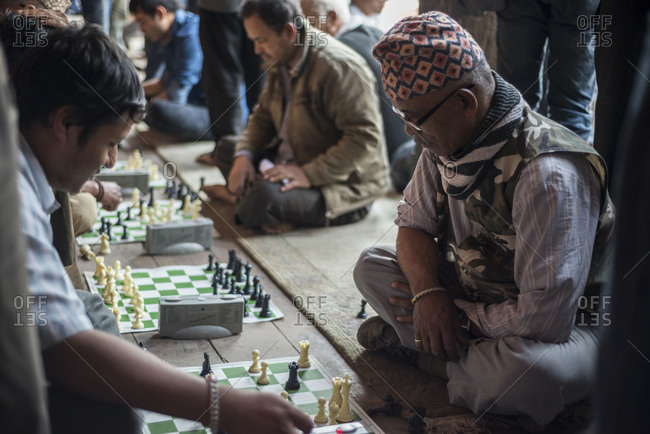Bhaktapur, Nepal - April 12, 2014: Men sit in a park and play chess, Nepal
