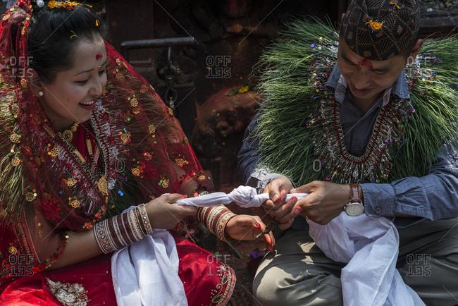 Kathmandu, Nepal - April 22, 2014: A bride and groom tie their nuptial knot in Nepal