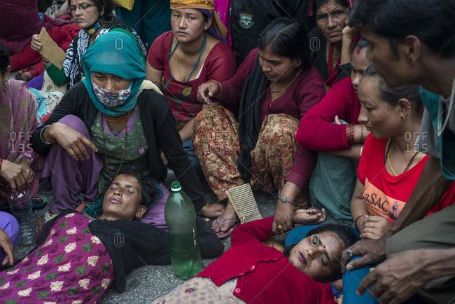 Kathmandu, Nepal - April 22, 2014: Two epileptic woman lay down, Nepal