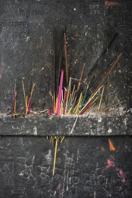 Incense burns at a shrine