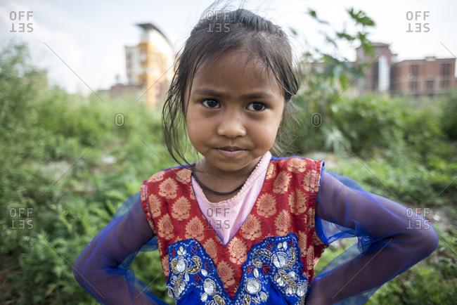Kathmandu, Nepal - May 25, 2014: Portrait of a young girl, resident of the Thapathali slum in Kathmandu, Nepal