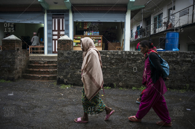 Dolakha, Nepal - June 6, 2014: Women walk down the street in a town in Dolakha, Nepal