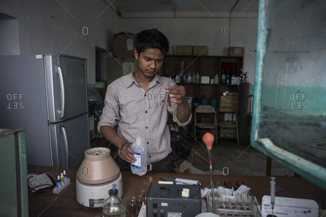 Dolakha, Nepal - June 7, 2014: A scientist works in a laboratory in Dolakha, Nepal