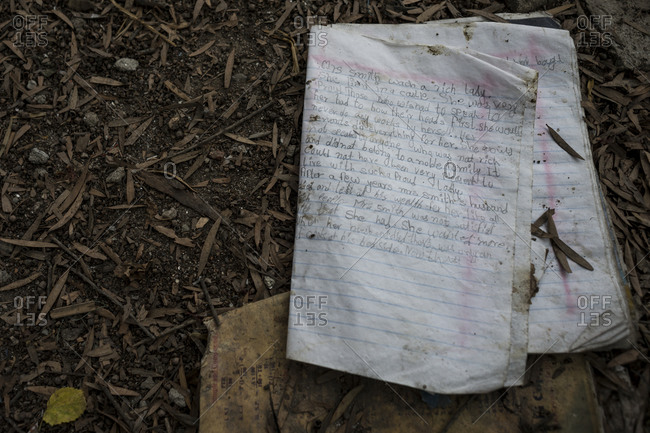 A child's notebook lays on the ground in the slums of Thapathali, Kathmandu, Nepal