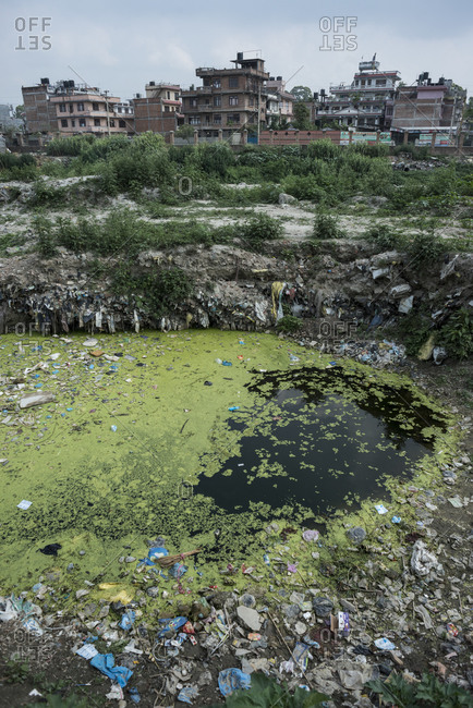 A trash-filled pond in the slums of Thapathali, Kathmandu, Nepal