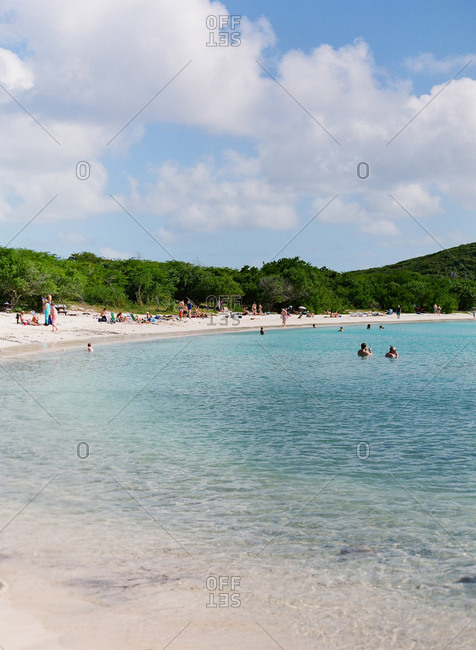 Vacationers enjoying a tropical beach in the Caribbean
