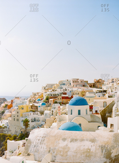 Church with blue cupola in village of Oia in Greece