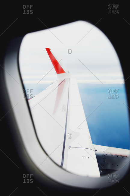 View of an airplane wing through a window
