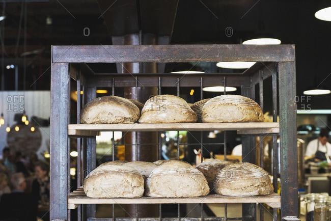 Racks of fresh loaves of bread