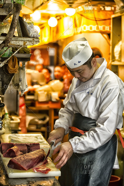 Tokyo, Japan - April 12, 2012: A chef prepares fish at the Tsukiji Fish Market