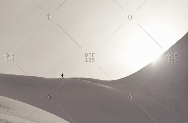 A skier on top of a snow-covered mountain