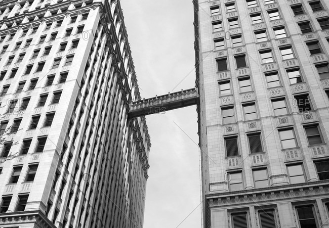 Looking up at a walkway connecting two towers of the Wrigley Building in Chicago