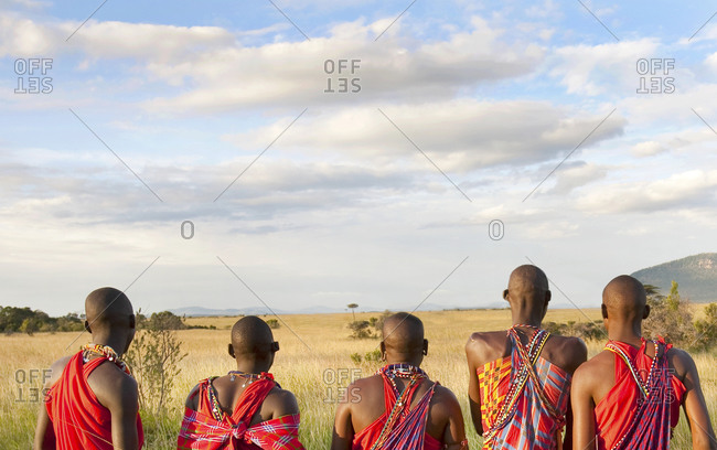 Back view of Maasai men gazing out at the savanna
