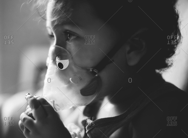 Portrait of girl wearing nebulizer