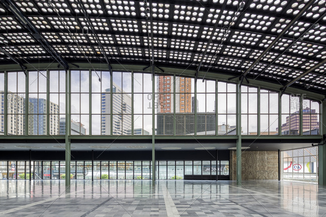 Rotterdam, Netherlands - June 1, 2015: View on office buildings and shops from the interior of the WTC, a modern building integrated with an old monument in Rotterdam
