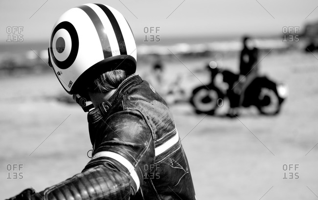 Person wearing a helmet on his motorcycle