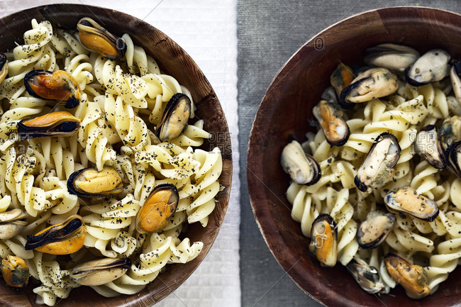 Bowls of pasta with mussels