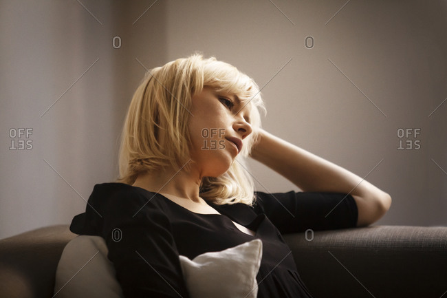 A woman relaxes on a couch