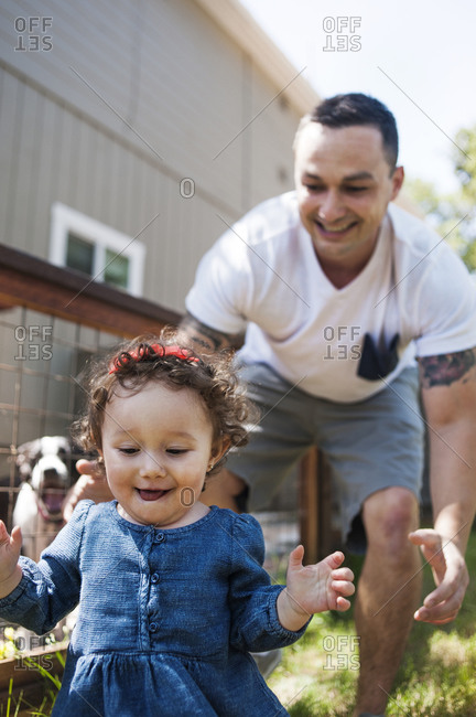 Man playing with his daughter at a kennel