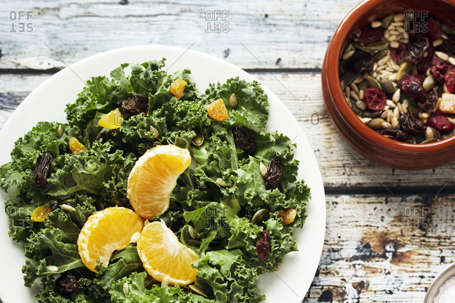 Kale salad with dried fruit and citrus