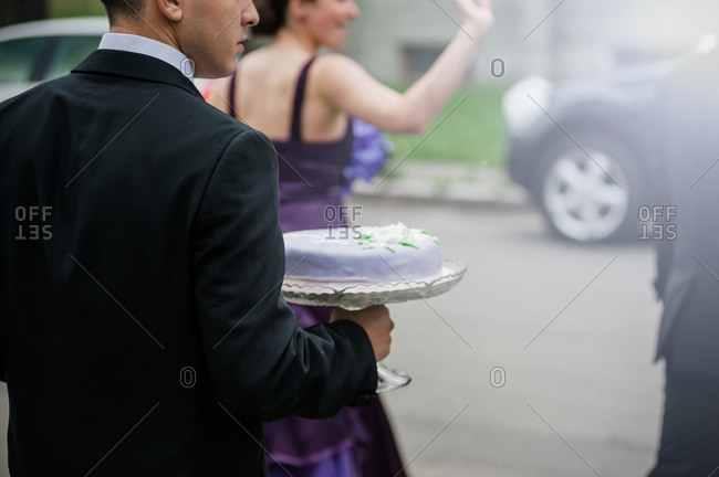 Man holding traditional Romanian cake before the wedding ceremony