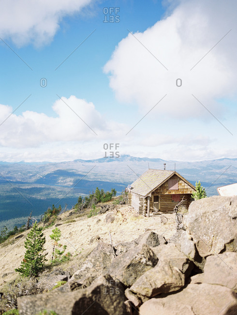 A cabin on top of a butte