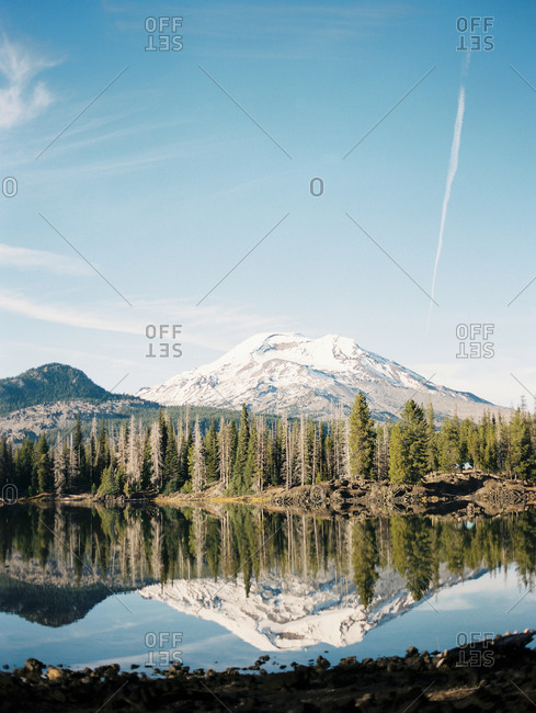 A mountain reflection in calm lake water