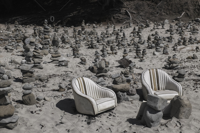 Empty armchairs and stack stones