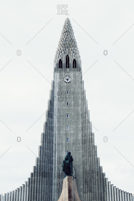 Reykjavik, Iceland - February, 10, 2015: Low angle view of Hallgrimur's Church with statue in front