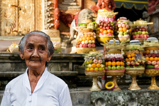 Ubud, Indonesia - May 29, 2015: An old Indonesian woman celebrating a religious festival