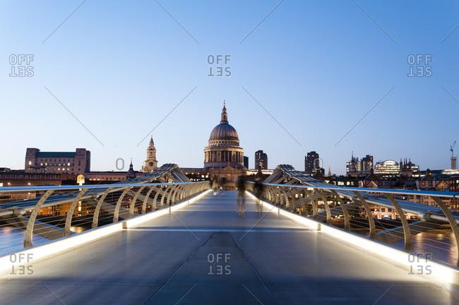 London, United Kingdom - May 10, 2011: Millennium Bridge, St. Paul's Cathedral at sunset