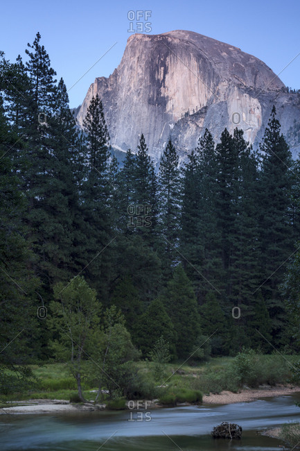 Half dome towering above river in Yosemite National Park