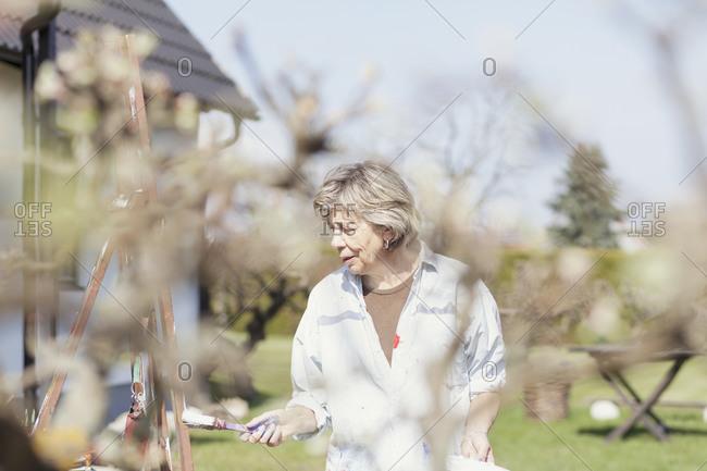 Senior female artist working en plein air