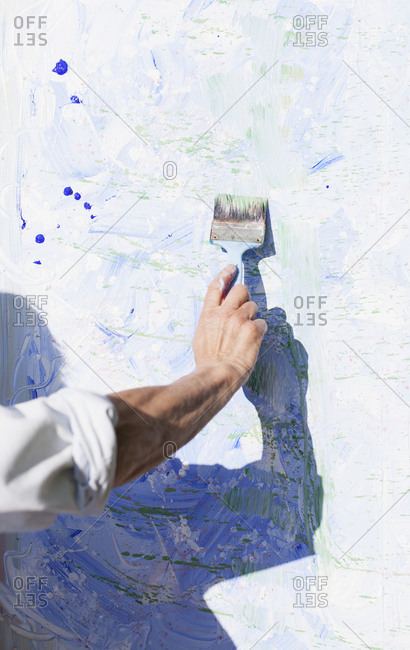 Close up of an artist painting outdoors