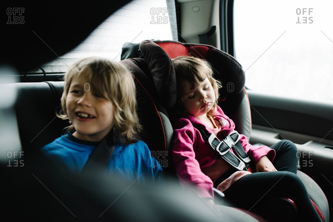 Two children in the back of a car