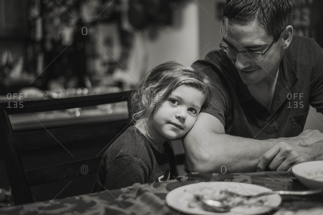 Father and daughter at the dinner table