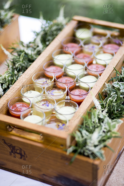 Tray of shot glasses of chilled soups at a wedding reception