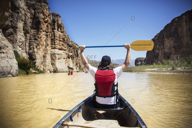 Excited man in a canoe