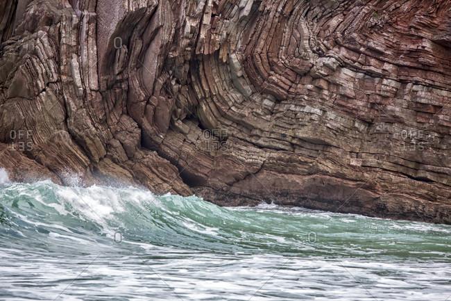 Surf at rocky coast, Llanes