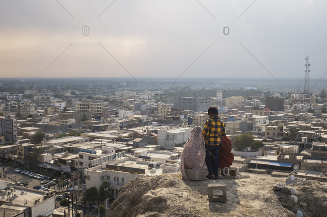 Minab, Iran - February 5, 2015: Young friends enjoying the views over Minab city towards the Persian Gulf