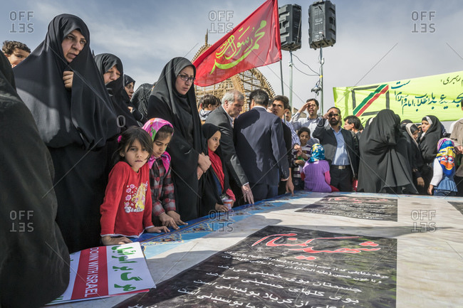 Yazd, Iran - February 11, 2015: Young girls and their mothers during rallies, or 'Ten Days of Dawn' protests, remembering the 36th anniversary of the Islamic Revolution
