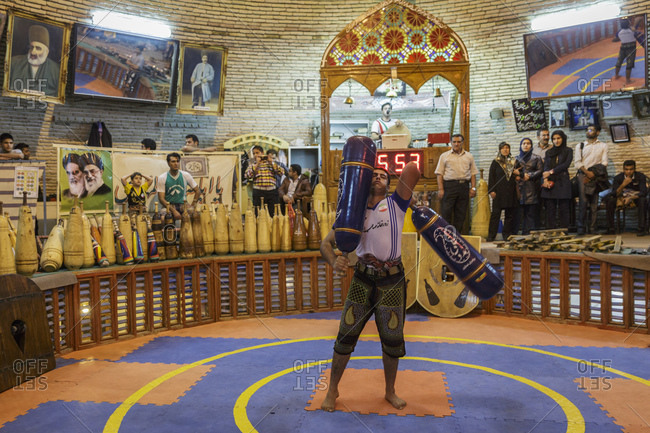 Yazd, Iran - February 12, 2015: Training in a traditional gym for the Iranian martial art of Zurkhaneh, which is Persian for 'House of Power'. The practice dates back more than 800 years, when Persia was invaded by the Mongols