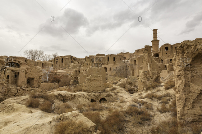 Kharanagh Village, Iran - February 12, 2015: The ancient mud brick city of Kharanagh, thought to be thousands of years old, first settled by Zoroastrians during the Sasanid Empire, a Persian dynasty which lasted from  the 3rd to the 7th century AD